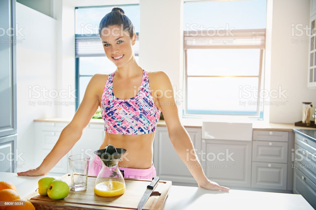 Healthy young peson making fresh juice mix stock photo