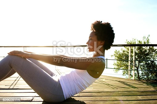 520047182istockphoto Healthy young woman doing abs crunches 639025114