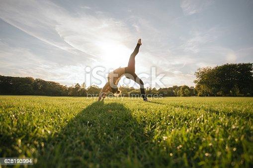 istock Healthy young woman doing yoga 628193994