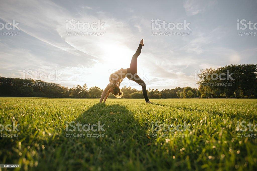Healthy young woman doing yoga stock photo