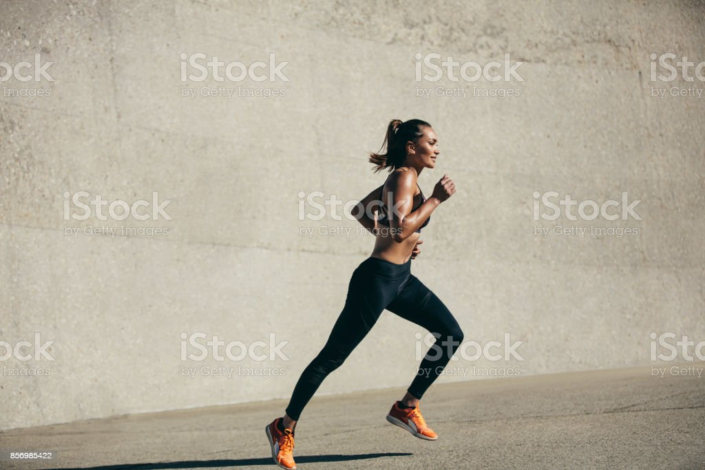 Healthy young woman on morning run stock photo