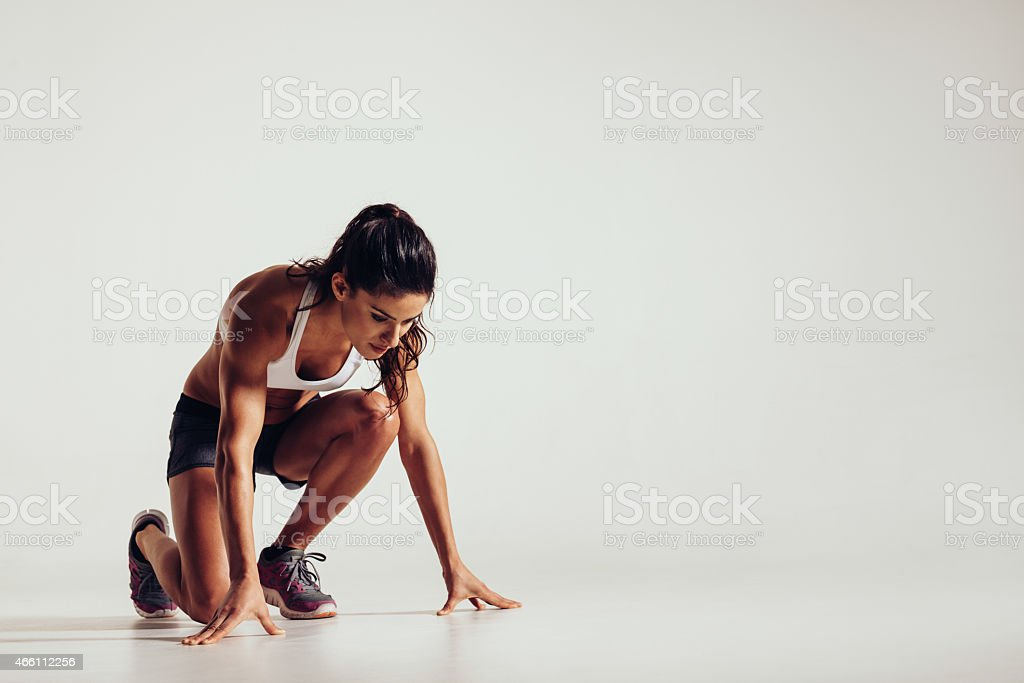 Healthy young woman preparing for a run stock photo