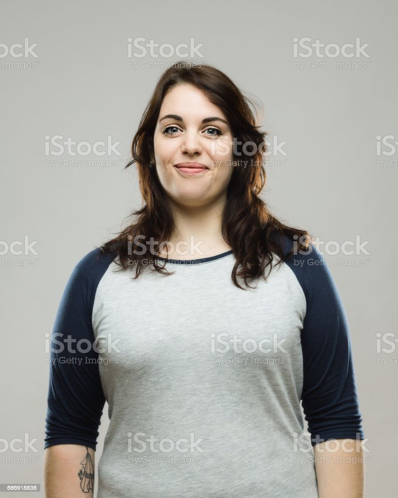 Healthy young woman smiling on gray background stock photo
