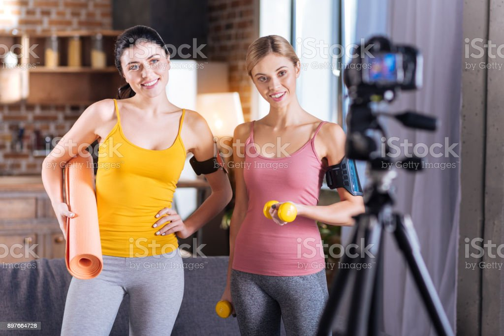Healthy young women recording workout video stock photo