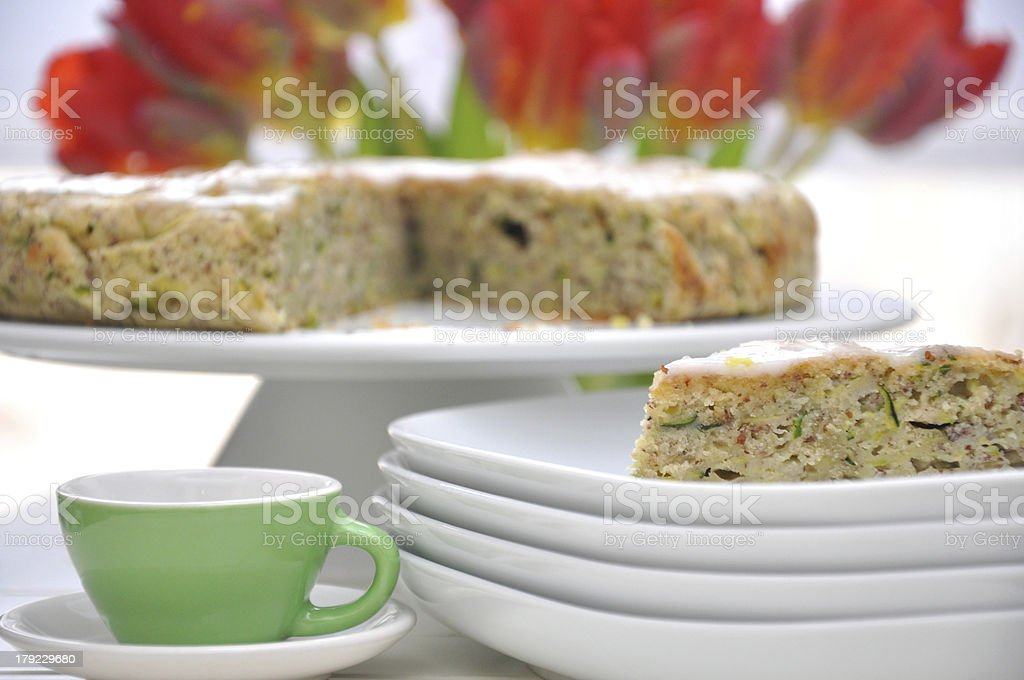 Healthy Zucchini Cake with tulips in the background stock photo