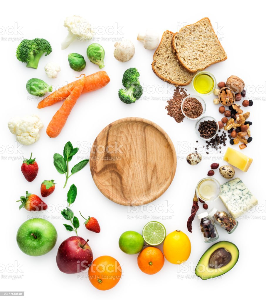 Healty eating, vegatables, fruits, empty wooden plate stock photo