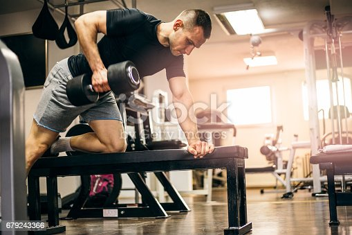 Healty Man Exercising with Arm Weights
