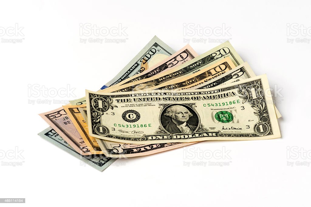 Heap of American Dollars on White Background. stock photo
