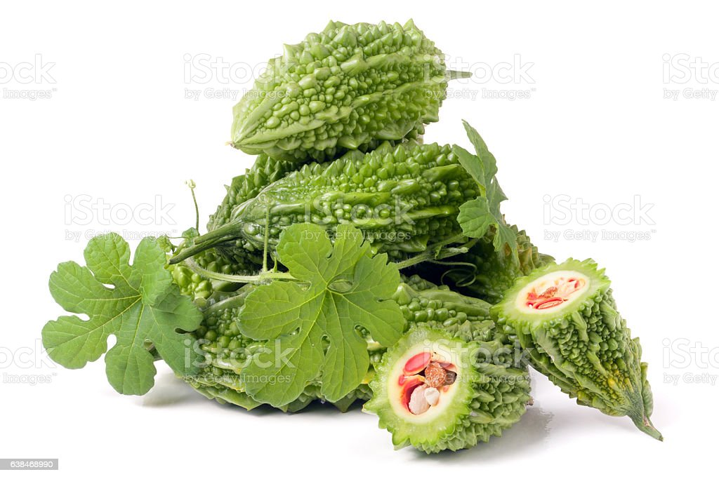 heap of bitter melon or momordica with leaves isolated on stock photo