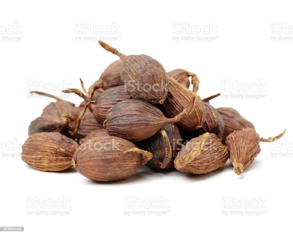 Heap of black cardamom fruit isolated  on white background stock photo