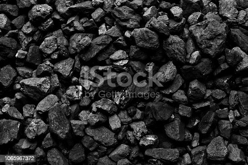istock A heap of black natural coal background 1065967372