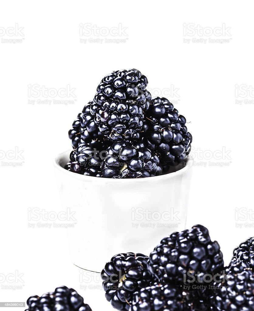 Heap Of Blackberries In A Cup Isolated On White Background Royalty Free Stock Photo