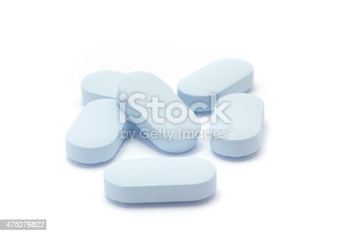 istock Heap of blue pills on a white background 475276822