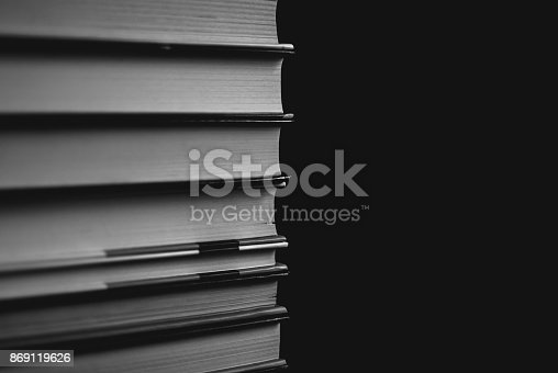 istock Heap of books on the cork board. Closeup of pages. 869119626