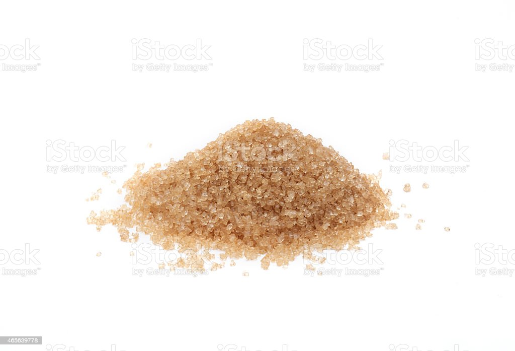 Heap of brown sugar texture isolated stock photo