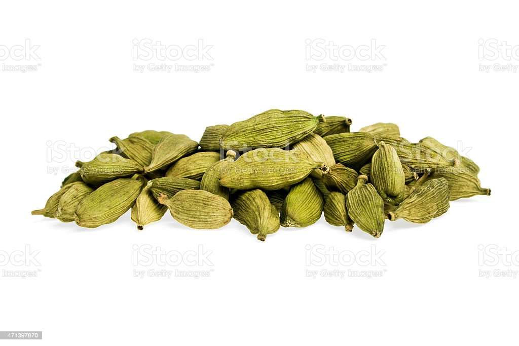 Heap of cardamom seeds isolated on white background stock photo