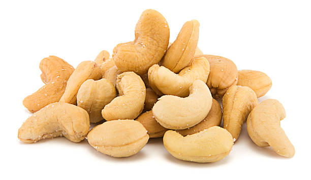 heap of cashew - cashew stock photos and pictures