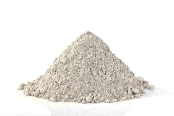 Heap of cement powder intended for industry isolated Heap of cement powder intended for industry isolated on white. cement stock pictures, royalty-free photos & images