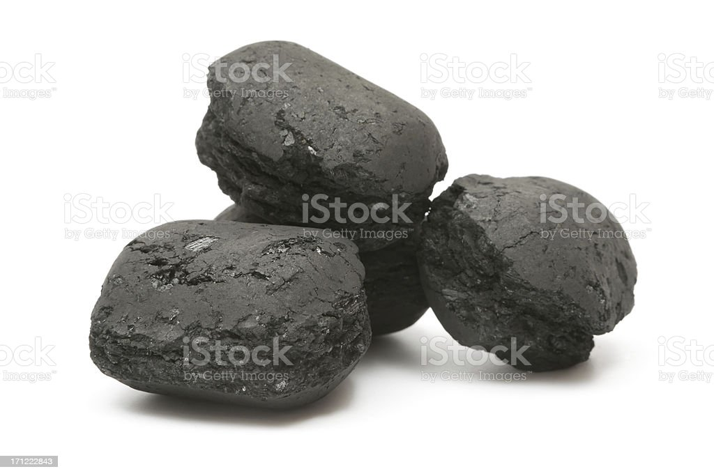 Heap of Charcoal Briquettes stock photo