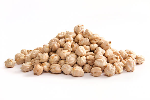 Heap of Chickpeas Heap of chickpeas on white background. chick pea stock pictures, royalty-free photos & images