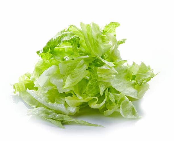 Heap of chopped iceberg lettuce Heap of chopped iceberg lettuce isolated on white background chopped food stock pictures, royalty-free photos & images