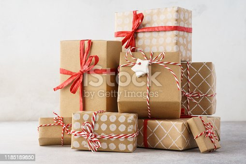 istock A heap of Christmas or Valentine Day handcrafted gift boxes. 1185189850