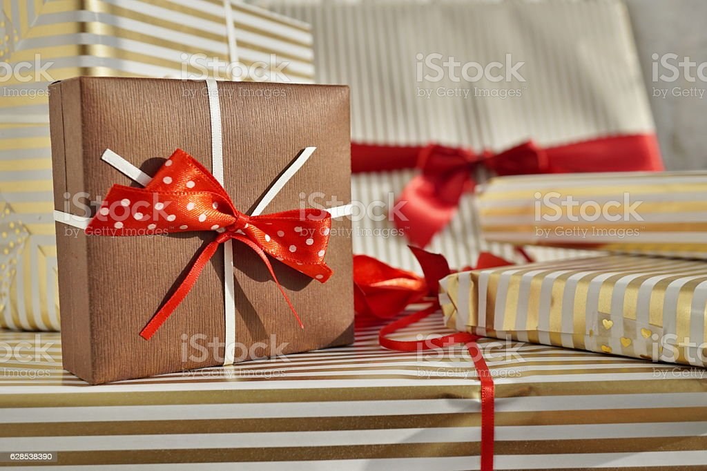 Heap Of Christmas Presents With A Small Brown Gift Box Royalty Free Stock Photo