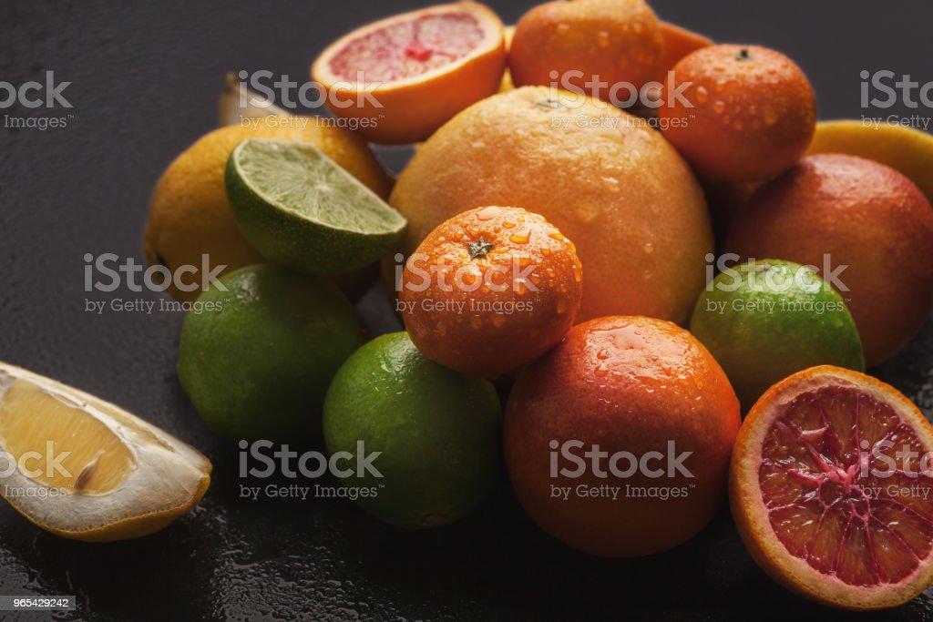 Heap of citruses on black background, closeup zbiór zdjęć royalty-free