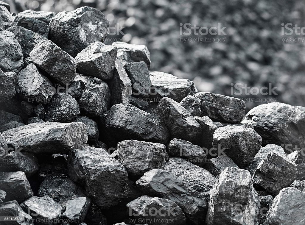 Heap of coal.Coal is stored for selling. stock photo