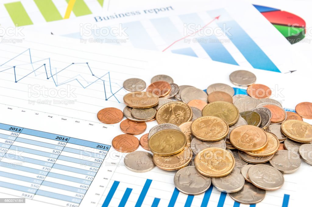 Heap of coins on the business graphs. Business concept. royalty-free stock photo