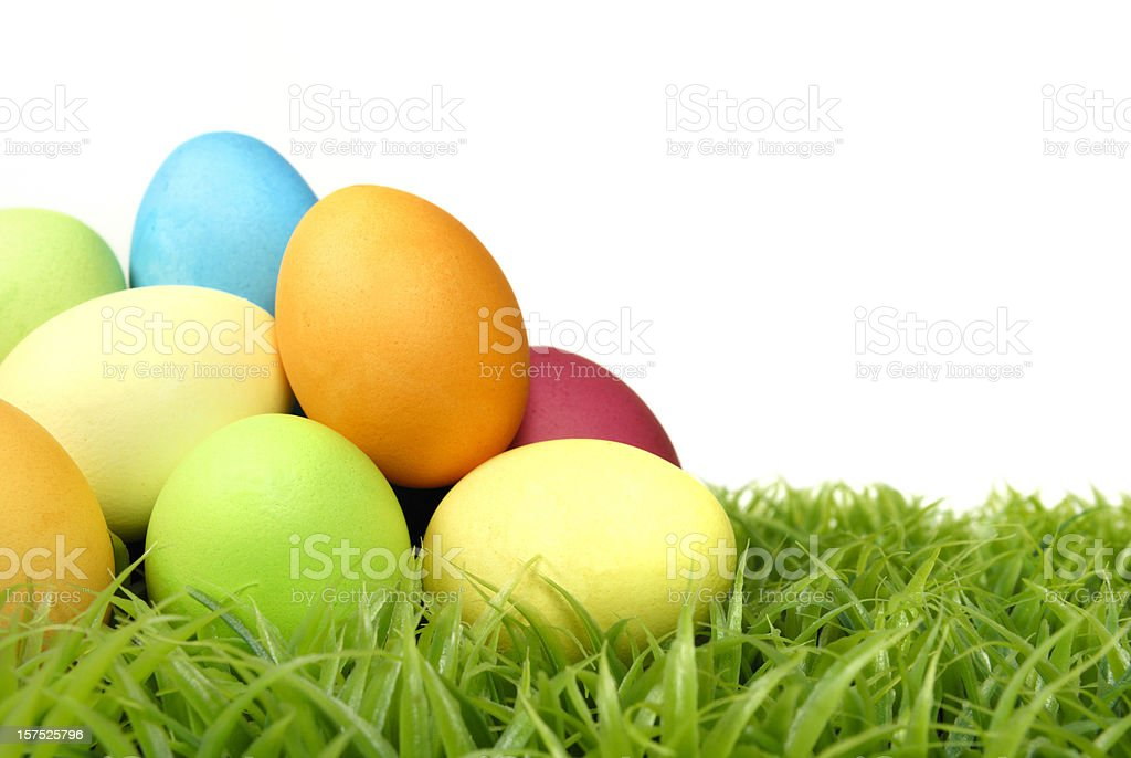 A heap of colored Easter eggs on the grass royalty-free stock photo