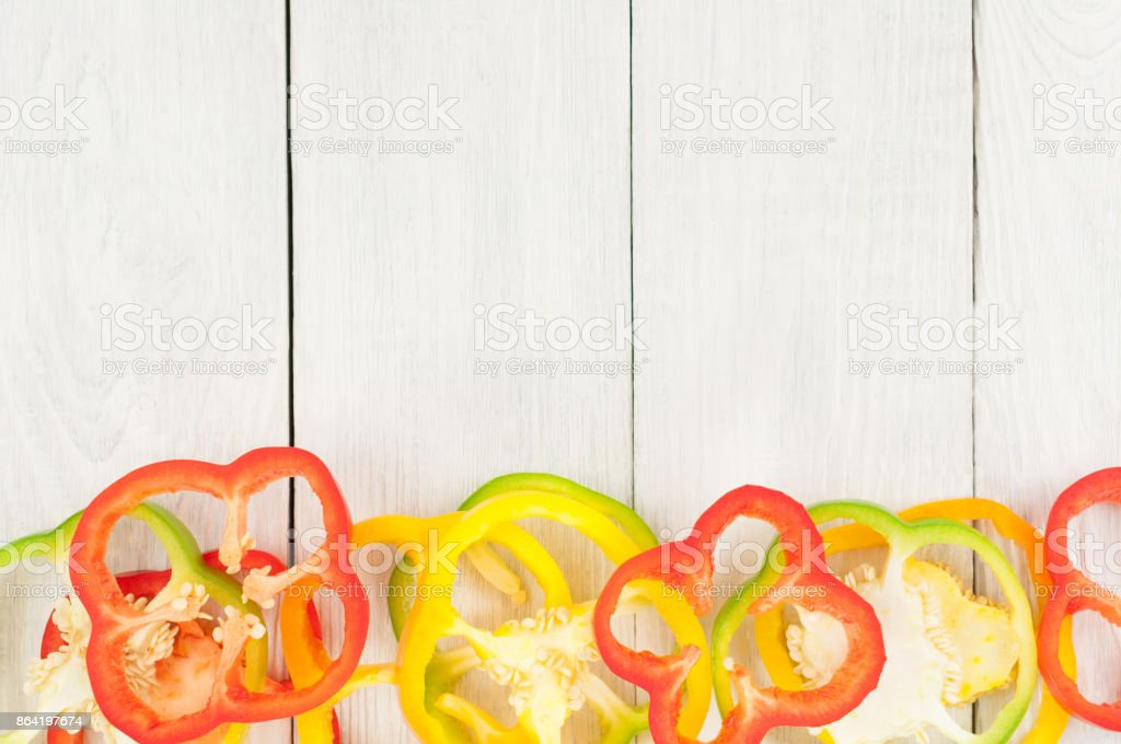 Heap of colored red and green and yellow fresh ripe raw pepper on old rural white wooden planks royalty-free stock photo