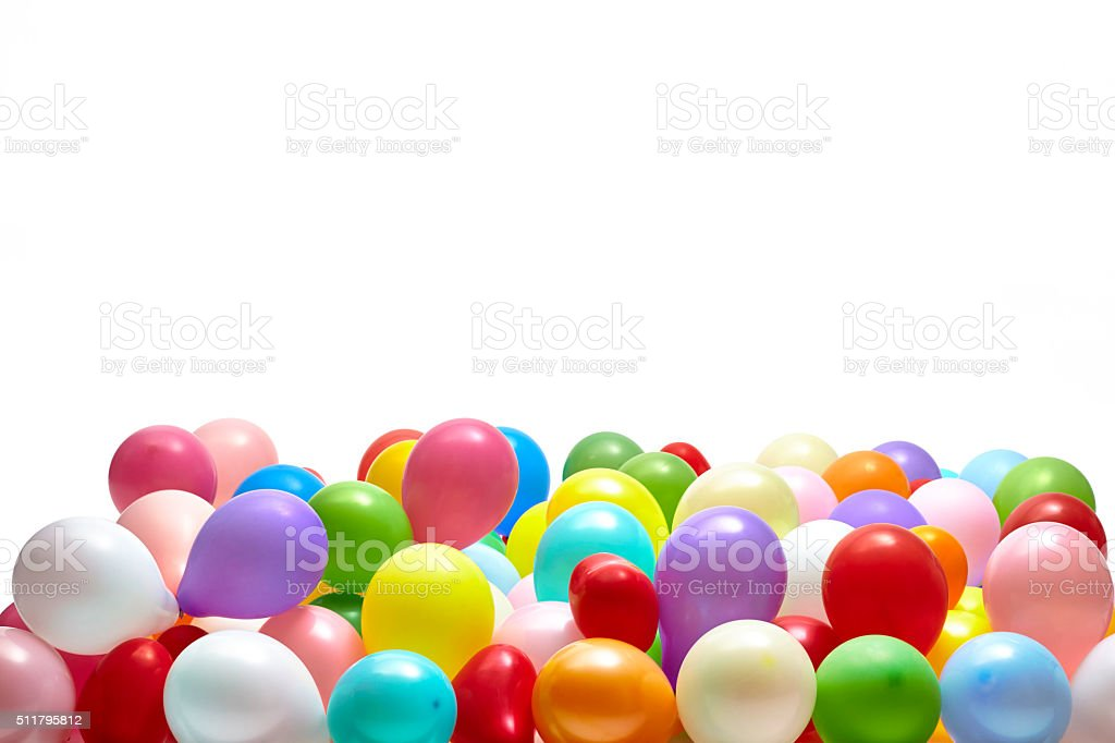 Heap of colorful balloons on white background studio shot stock photo