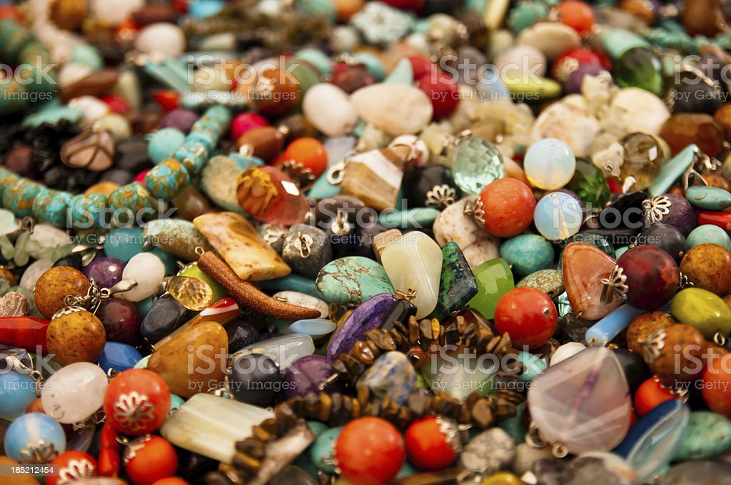 Heap of colorful bright stone jewelry stock photo