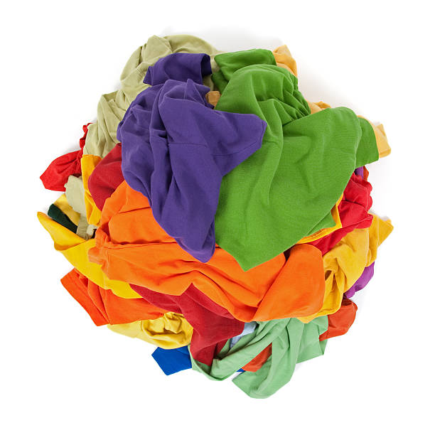 Heap of colorful clothes from above stock photo