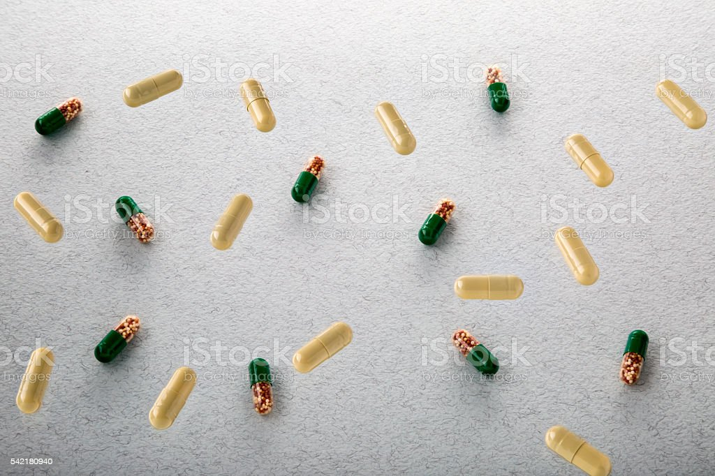 Heap of colorful drugs and pills stock photo