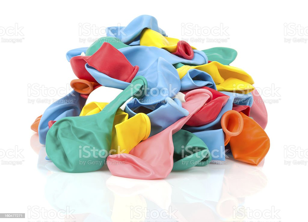 Heap of colorful empty balloons, isolated on white royalty-free stock photo