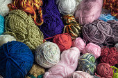 Heap of colorful knitting balls, top view