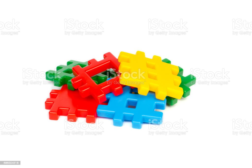 Heap of colorful plastic building blocks isolated on white stock photo