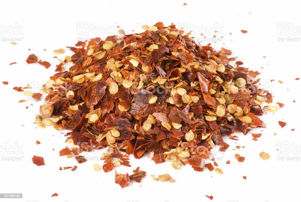 Heap of crushed chili isolated on white stock photo