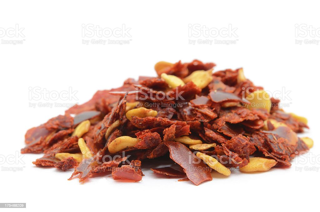 Heap of Crushed Chili Pepper on White Background stock photo