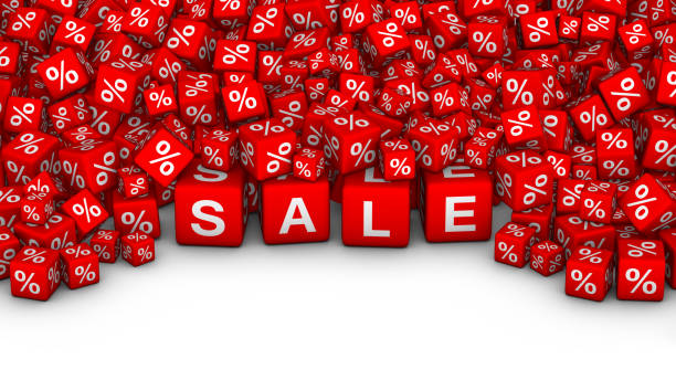 A heap of cubes with SALE word and percent symbol. stock photo