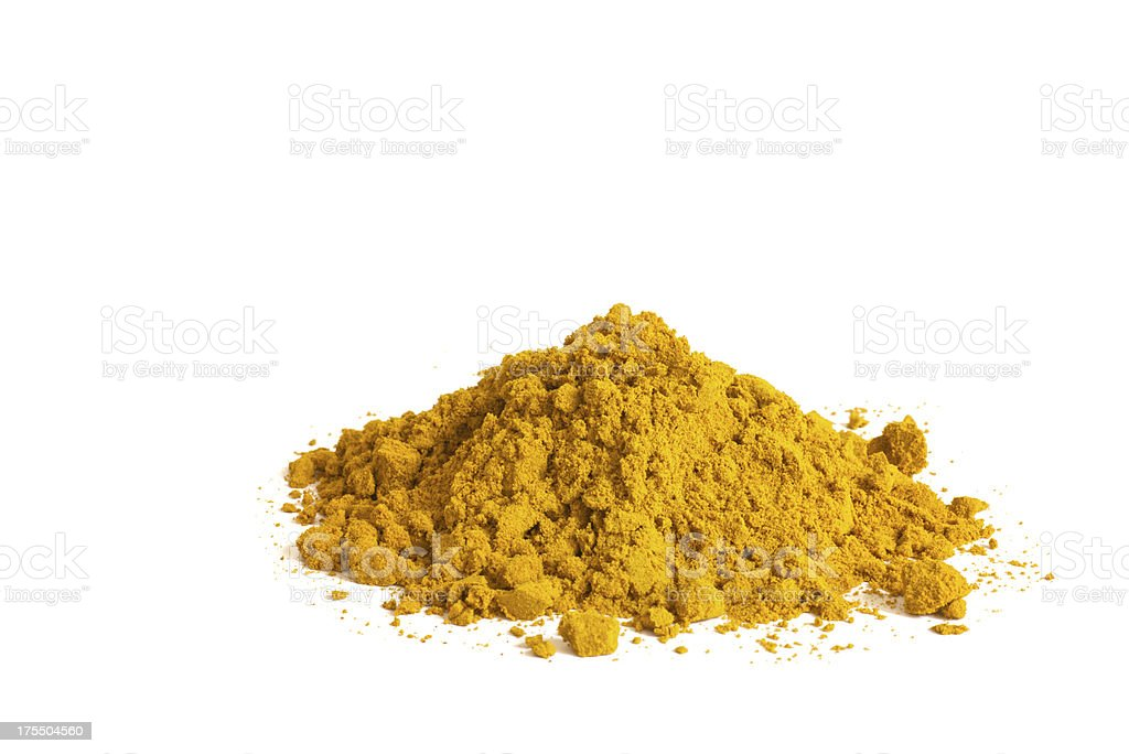 heap of curry powder on white background stock photo