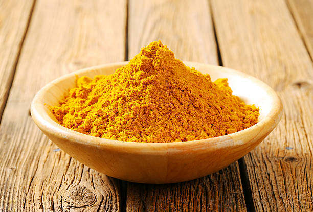 Heap of curry powder Heap of curry powder in a bowl curry powder stock pictures, royalty-free photos & images