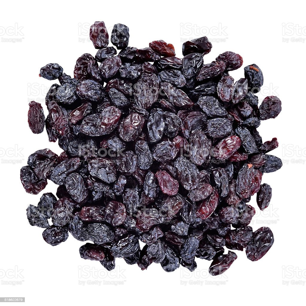 Heap of dark raisins on a white stock photo
