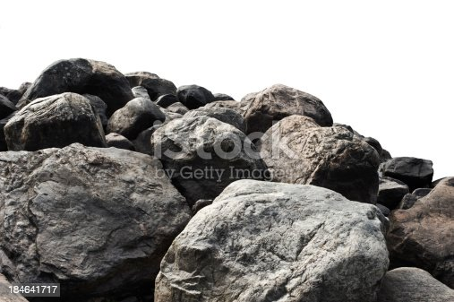 Heap of dark stones isolated on white background.