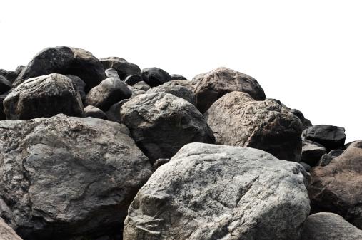 Heap of dark stones isolated on white background.