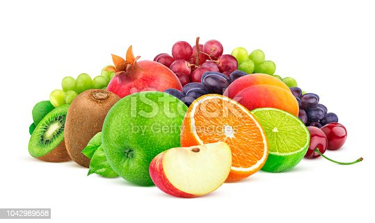 Heap of different fruits and berries isolated on white background with clipping path