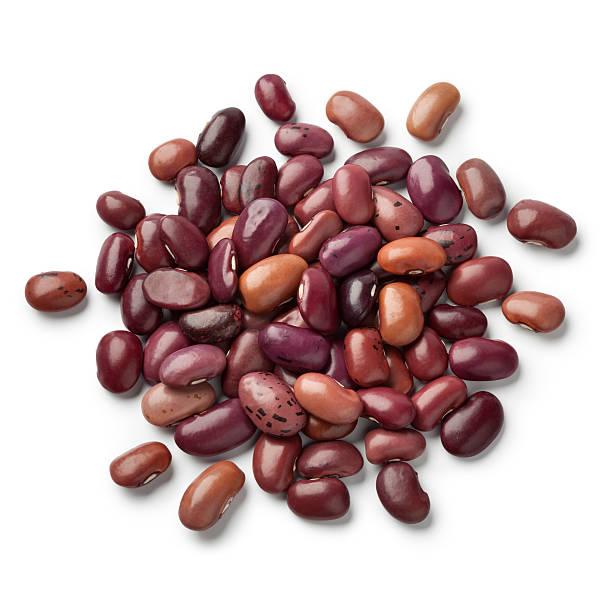 heap of dried ayuote morado beans - fasulye stok fotoğraflar ve resimler