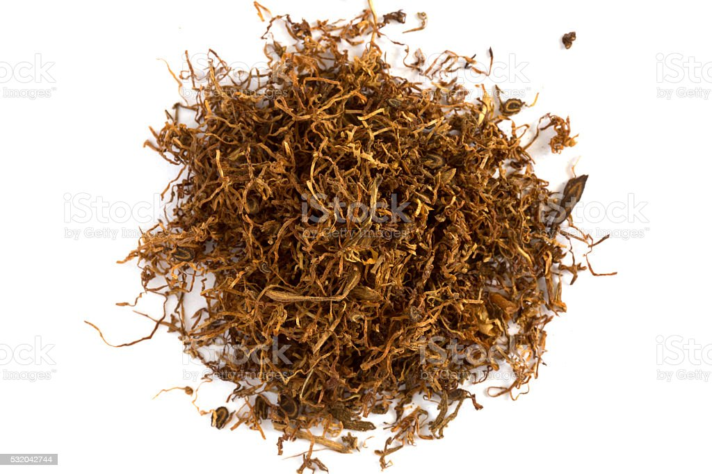 Heap of dry Pipe Tobacco on white stock photo